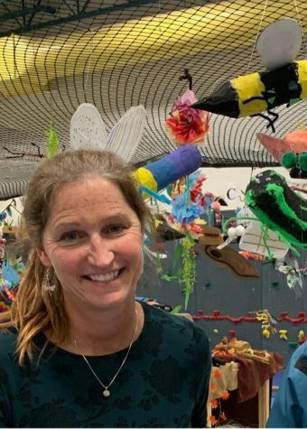 Pike poses in front of her students tropical rainforest display!